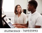 male pupil with teacher playing ... | Shutterstock . vector #769555993