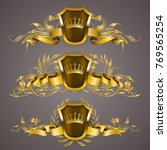 set of golden royal shields... | Shutterstock .eps vector #769565254