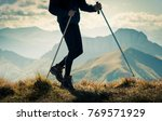 hiking in mountains | Shutterstock . vector #769571929
