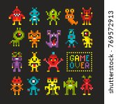cool set of 8 bit monsters and... | Shutterstock .eps vector #769572913