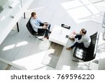 business meeting in lobby   Shutterstock . vector #769596220