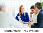 business people using devices | Shutterstock . vector #769596388