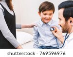 doctor examination little boy... | Shutterstock . vector #769596976