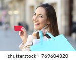 portrait of a happy shopper... | Shutterstock . vector #769604320