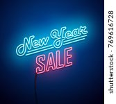 new year sale neon sign. vector ... | Shutterstock .eps vector #769616728