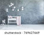 pink blanket on white crib with ... | Shutterstock . vector #769627669