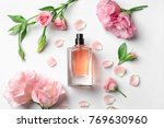 bottle of perfume with flowers...   Shutterstock . vector #769630960