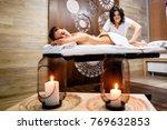 female masseur doing massage on ... | Shutterstock . vector #769632853