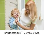 child oral care. mom is helping ... | Shutterstock . vector #769633426