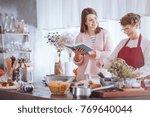 happy grandmother mixing... | Shutterstock . vector #769640044