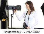 beautiful female photographer...   Shutterstock . vector #769643830