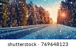 winter road covered with snow | Shutterstock . vector #769648123