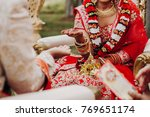 indian bride in red lehenga... | Shutterstock . vector #769651174