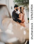 handsome groom and stunning... | Shutterstock . vector #769653904