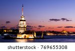 Small photo of Maiden Tower or Kiz Kulesi with floating tourist boats on Bosphorus in Istanbul at night
