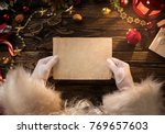 close up of santa claus hands... | Shutterstock . vector #769657603