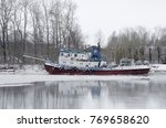 A Tugboat On The River During...