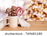 gingerbread man and candy in... | Shutterstock . vector #769681180