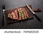 rare steak on cutting board...   Shutterstock . vector #769682020