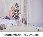 young pretty family with a... | Shutterstock . vector #769698388