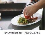 chef serves steak in restaurant   Shutterstock . vector #769703758