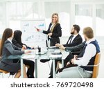 business team gives a... | Shutterstock . vector #769720498