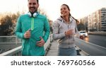 young attractive couple running ... | Shutterstock . vector #769760566