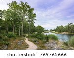 path alongside the coast in the ... | Shutterstock . vector #769765666