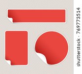 red stickers on beige striped... | Shutterstock . vector #769773514
