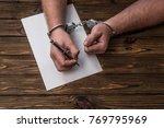 men's hands with handcuffs fill ... | Shutterstock . vector #769795969