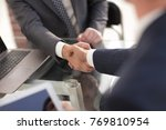 confident handshake of business ... | Shutterstock . vector #769810954