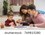 happy mother  father and son... | Shutterstock . vector #769815280