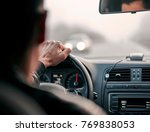 man holds the wheel with one hand during the trip - stock photo