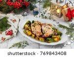 christmas dinner   fried pork...   Shutterstock . vector #769843408