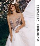 beautiful romantic young woman... | Shutterstock . vector #769843588