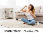 smiling redhead girl listening... | Shutterstock . vector #769862296