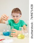 young scientist in safety... | Shutterstock . vector #769871428