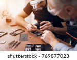 elderly and young men repair a... | Shutterstock . vector #769877023