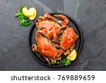 cooked crabs on black plate... | Shutterstock . vector #769889659