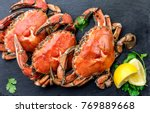 Cooked crabs on black plate...