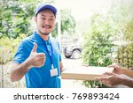 delivery boy sending pizza box... | Shutterstock . vector #769893424