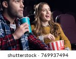 young couple with popcorn... | Shutterstock . vector #769937494