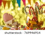 colored candies on a yellow... | Shutterstock . vector #769946914