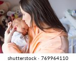 a young mother enjoys the first ... | Shutterstock . vector #769964110