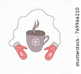 mittens and cup of hot tea or...   Shutterstock .eps vector #769966210