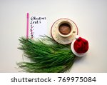 a cup of coffee and christmas... | Shutterstock . vector #769975084