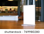 mock up menu frame standing on... | Shutterstock . vector #769980280