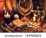 old books  black candles ... | Shutterstock . vector #769980826