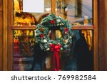 christmas wreath on the store... | Shutterstock . vector #769982584