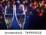 two champagne glasses ready to... | Shutterstock . vector #769993018